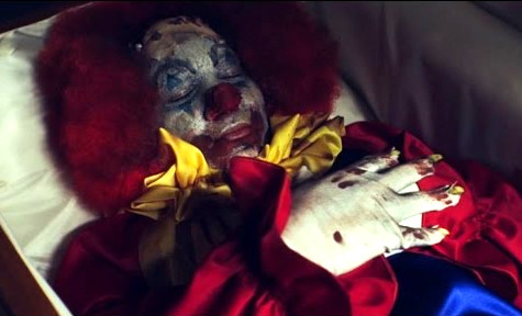 night watchmen clown in coffin