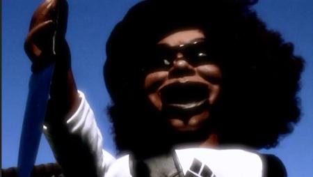 black devil doll with knife
